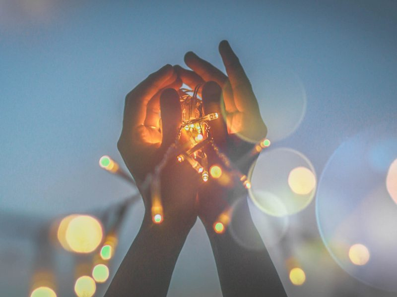 hands holding a small light