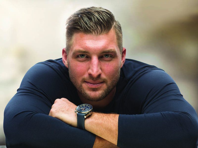 Tim Tebow with arms crossed