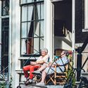 elderly couple sitting on porch