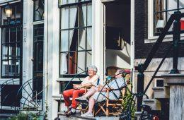elderly couple sitting on porch