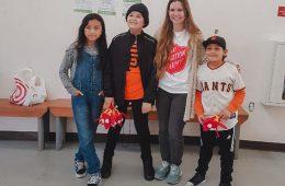 Elizabeth Veras Holland with children smiling