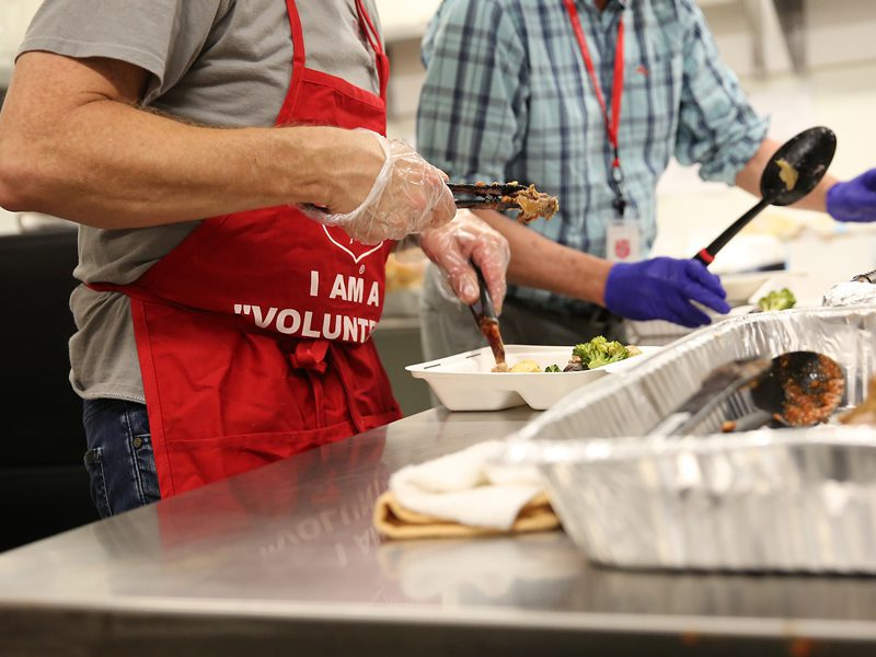 closeup of EDS volunteers preparing meals