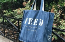 Blue FEED Project Bag in Front of Plants