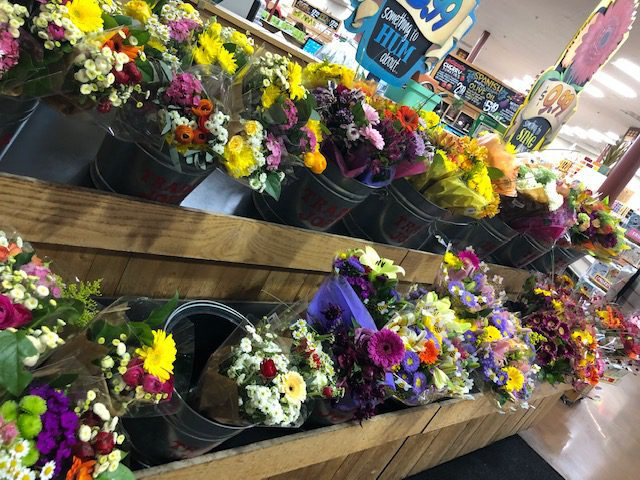 Flower Bouquets Displayed on Shelf in Store