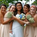 Female Friends Hugging and Smiling Around Bride