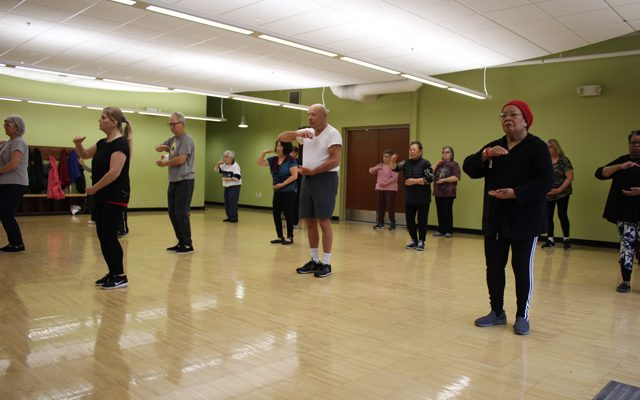 Tai Chi Class Participants Practicing