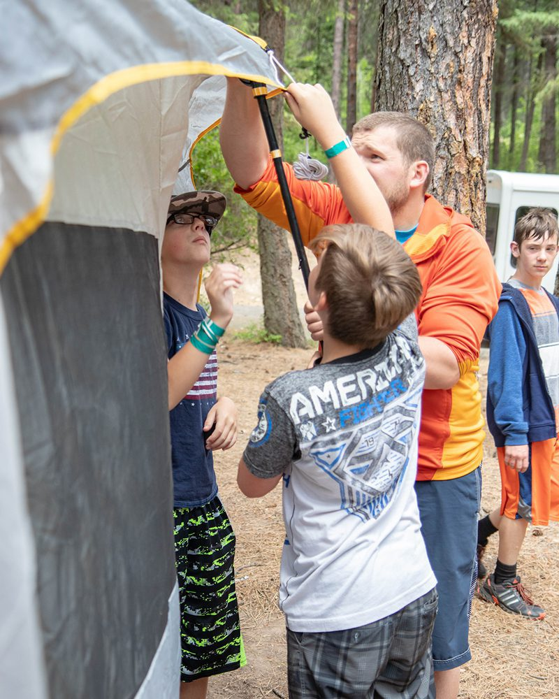 Coeur d'Alene Kroc Center Counselor Helping Set Up Tent with Campers