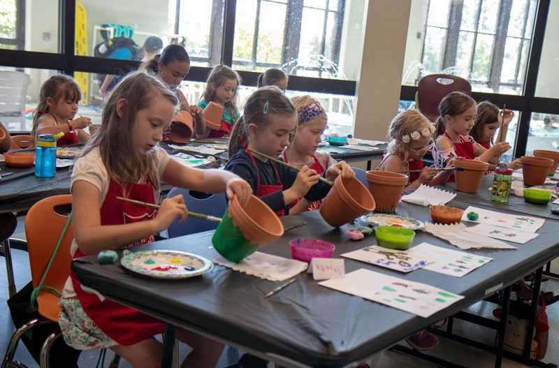 Girl Campers at Coeur d'Alene Kroc Center Painting Flower Pots