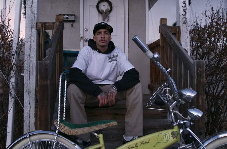 Robert Wallace Sitting on Porch with Custom Built Bike