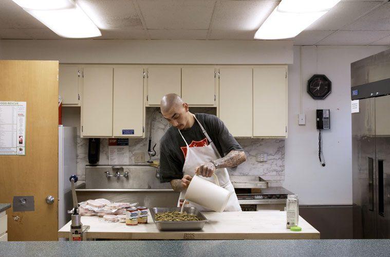 Robert Wallace Preparing Food in Salvation Army Kitchen