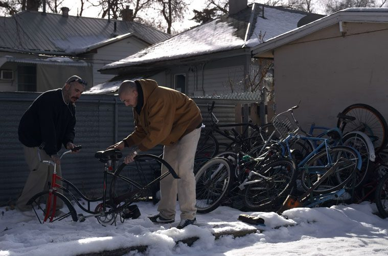 Robert Wallace and Friend Examining Bikes in Snow