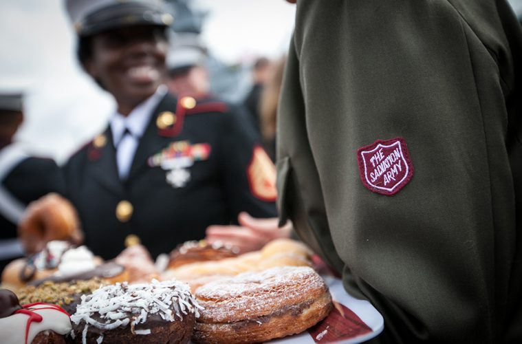 Salvation Army Soldiers Holding Donuts