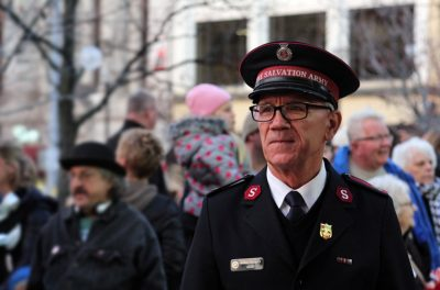 Man in Salvation Army Uniform with Crowd