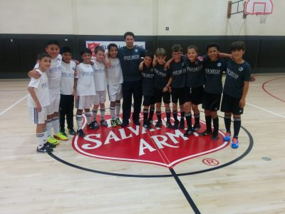 Eric Riddle Standing with Kids During Salvation Army Sports League