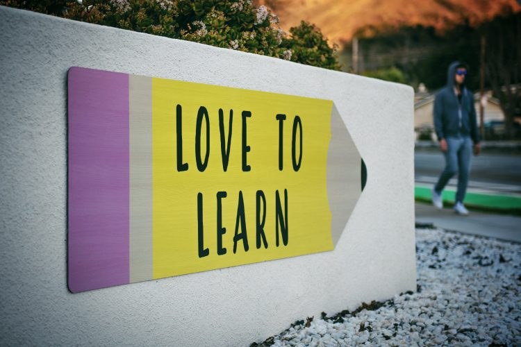 """Love to Learn"" Written on Poster Shaped like a Pencil"