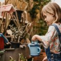 Young Girl Watering Plants