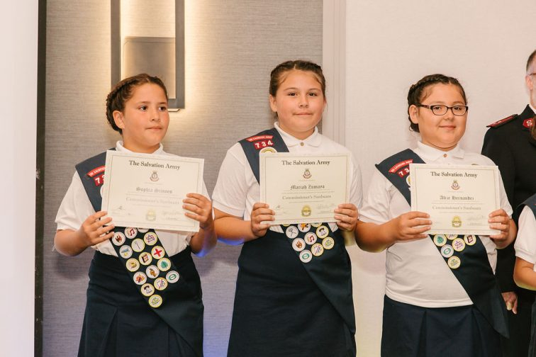 Three Sunbeam Troops with Badges Holding Commissioner's Award
