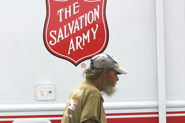 Homeless Man in front of TSA truck
