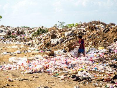 Child Dumping Trash on Beach