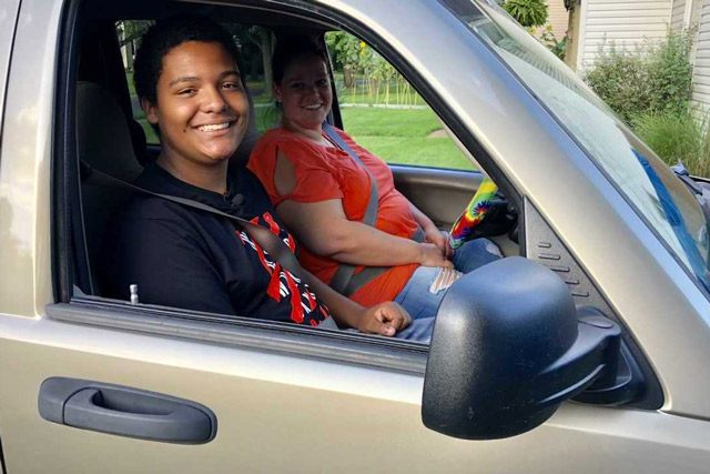 Treston Harris and Mother Sitting in New Car He Bought For Her