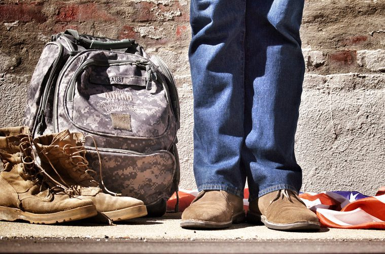 Veteran with army boots next to him in civilian clothes