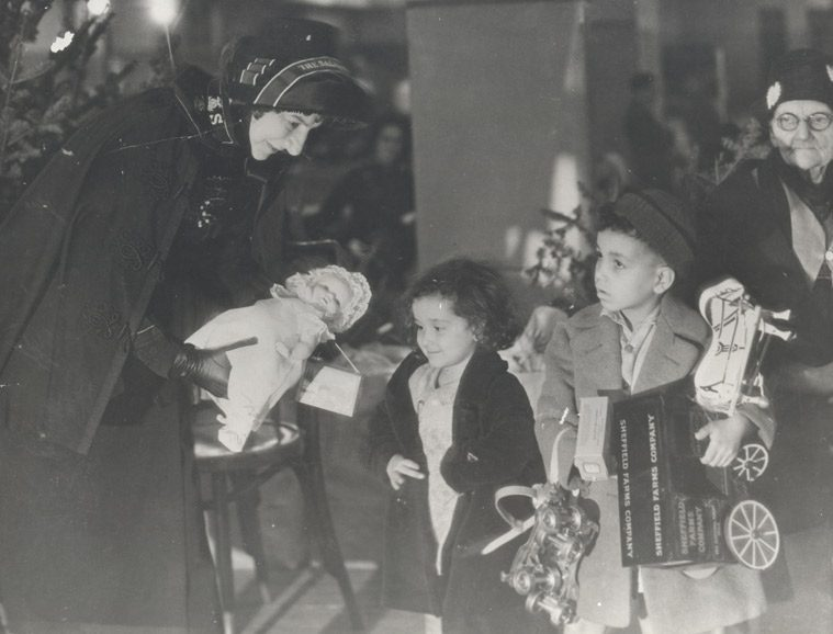 Evangeline Booth giving toys to children on Christmas