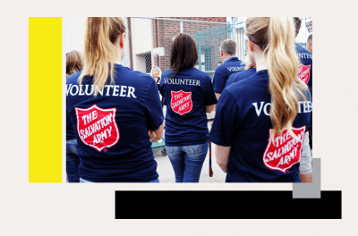Salvation Army Volunteers with backs turned in volunteer shirts