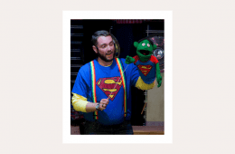 Captain Mark Davey in superman shirt with puppet wearing same shirt