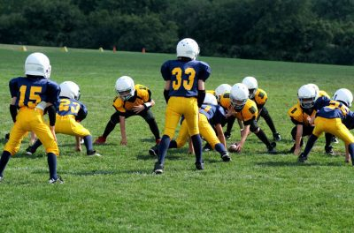 youth football team lined up before play