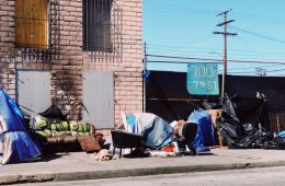 Homeless Woman by Tent on Street