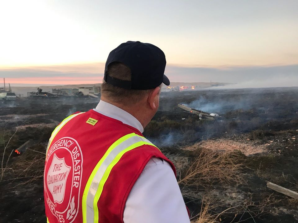 Salvation Army EDS Member Looking at Damage Caused by Fire
