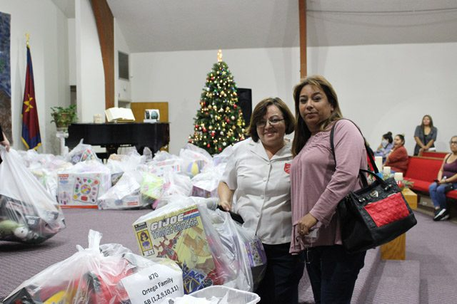 Women with Toy Donations