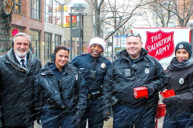 Members of Denver Police Department help as Bellringers