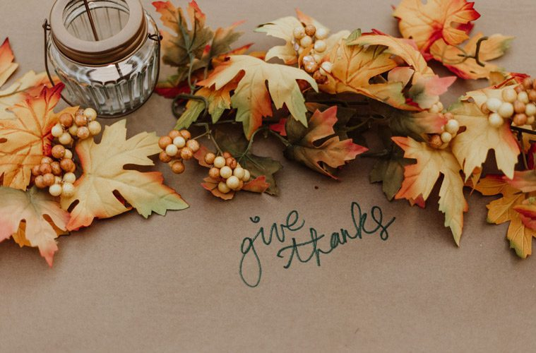 "Leaves surrounding the words ""give thanks"""