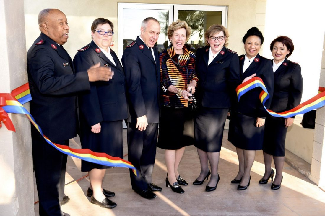 Diane McCarthy and Salvation Army Officers Cutting Ribbon