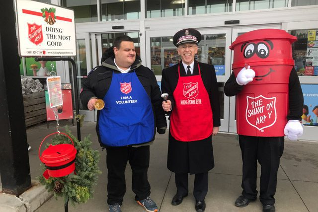 Harrison, Commissioner Hodder, and Kettle Man ringing bells outside