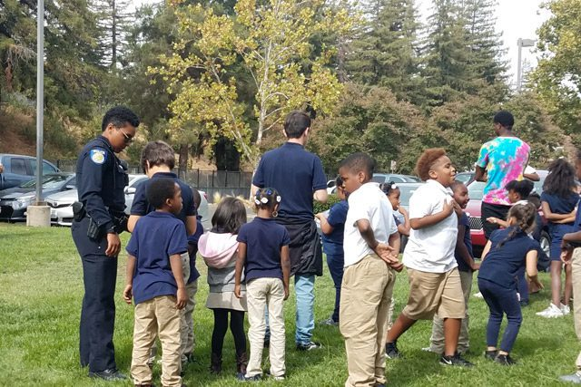 Sacramento Police Department Officer With Group of Kids