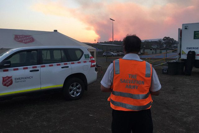 Salvation Army Emergency Worker looking at fires