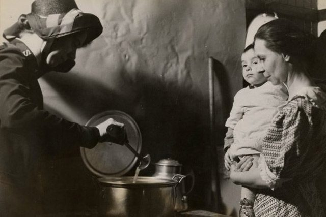 Salvation Army Mother serving soup