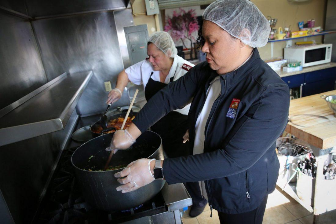 Salvation Army workers preparing food