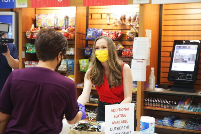 Woman at counter with face mask on