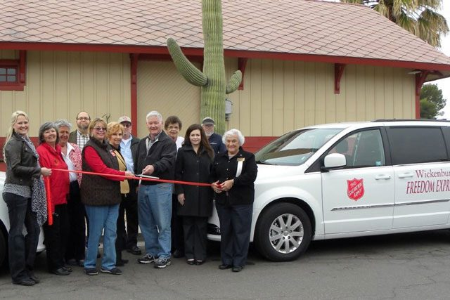 """Ribbon Cutting in front of """"Freedom Express"""" van"""