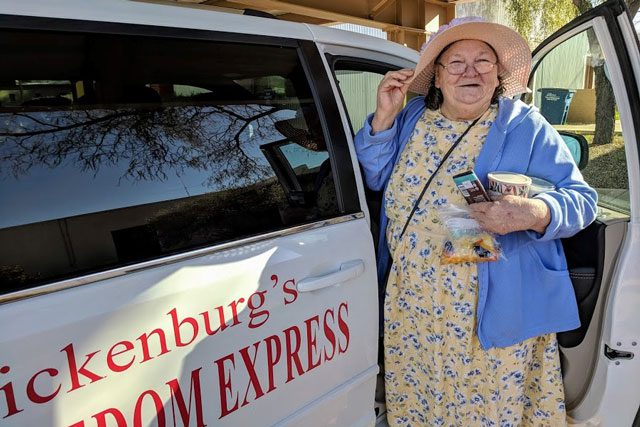 "Elderly woman getting into ""Freedom Express"" van"