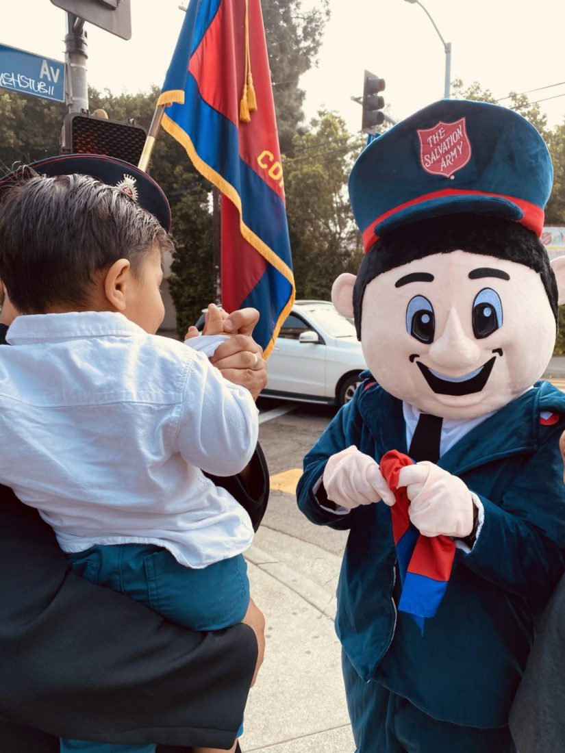 Salvation Army mascot with child