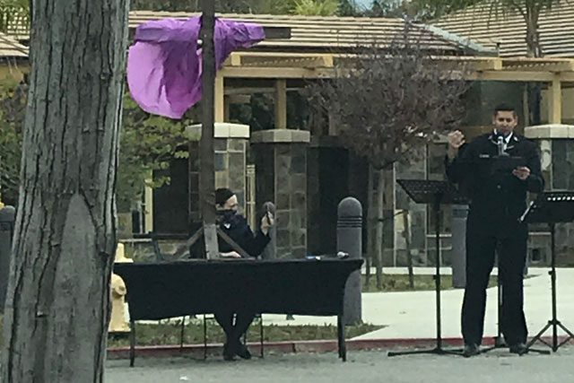 Salvation Army officer giving sermon outside