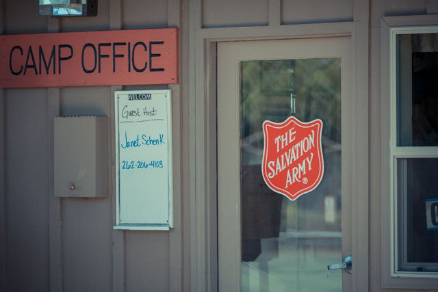 Building with Salvation Army logo hanging on glass door