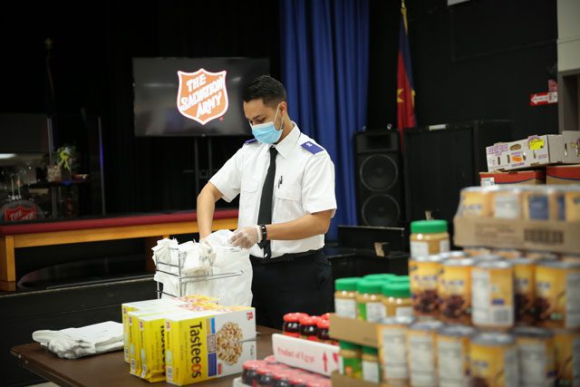 Salvation Army Officer preparing food bags