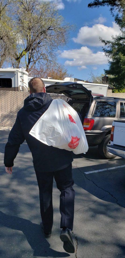 EDS worker holding bag