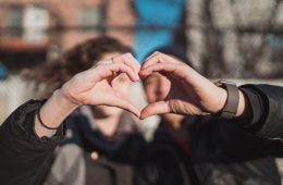 Hands together forming heart