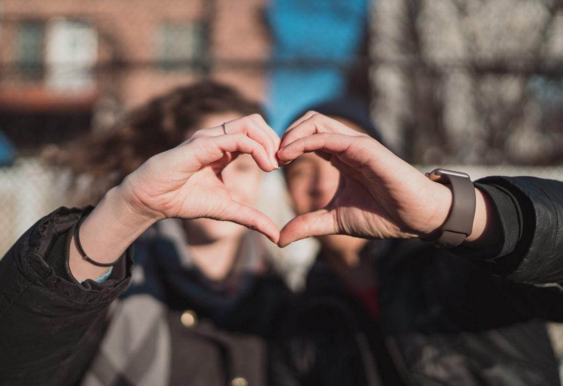 Hands together forming heart